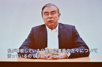 Former Nissan chief Carlos Ghosn speaks during a video message recorded before his most recent rearrest, during a press conference at the Foreign Correspondents' Club of Japan in Tokyo on April 9, 2019. - Japanese prosecutors rearrested Ghosn on April 4, who was out on bail, over an additional allegation that he transferred Nissan money to a dealership in Oman but siphoned off millions for personal expenses -- including the purchase of a luxury yacht. (Photo by CHARLY TRIBALLEAU / AFP)