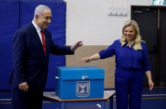 Israeli Prime Minister Benjamin Netanyahu and his wife Sara cast their votes during Israel's parliamentary elections in Jerusalem, on April 9, 2019. - Israelis voted today in a high-stakes election that will decide whether to extend Prime Minister Benjamin Netanyahu's long right-wing tenure despite corruption allegations or to replace him with an ex-military chief new to politics. (Photo by Ariel Schalit / POOL / AFP)