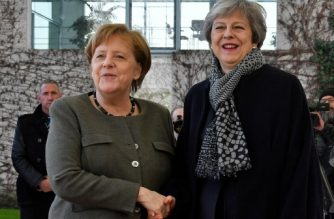 German Chancellor Angela Merkel (L) greets British Prime Minister Theresa May as she arrives at the Chancellery in Berlin on April 9, 2019. - Embattled British Prime Minister Theresa May is visiting Berlin on April 9, 2019 for talks with German Chancellor Angela Merkel before travelling to Paris. (Photo by John MACDOUGALL / AFP)
