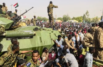 "Sudanese soldiers stand guard on armoured military vehicles as demonstrators continue their  protest against the regime near the army headquarters in the Sudanese capital Khartoum on April 11, 2019. - The Sudanese army is planning to make ""an important announcement"", state media said today, after months of protests demanding the resignation of longtime leader President Omar al-Bashir. Thousands of Khartoum residents chanted ""the regime has fallen"" as they flooded the area around army headquarters where protesters have held an unprecedented sit-in now in its sixth day. (Photo by - / AFP)"
