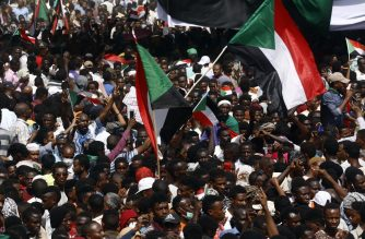 "Sudanese demonstrators gather in a street in central Khartoum on April 11, 2019, immediatly after one of Africa's longest-serving presidents was toppled by the army. - Organisers of protests for the ouster of Sudanese president Omar al-Bashir rejected his toppling by the army Thursday as a ""coup conducted by the regime"" and vowed to keep up their campaign. (Photo by ASHRAF SHAZLY / AFP)"