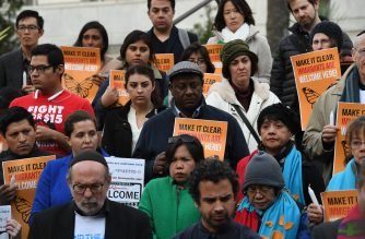 "(FILES) In this file photo taken on January 25, 2017 migrant rights groups look on during a vigil to protest against US President Donald Trump's new crackdown on ""sanctuary cities"", outside the City Hall in Los Angeles, California. - The White House pushed immigration authorities to release illegal migrants onto the streets of so-called ""sanctuary cities"" to retaliate against US President Donald Trump's political enemies, the Washington Post reported on April 11, 2019. (Photo by Mark RALSTON / AFP)"