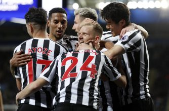 Newcastle United's Scottish midfielder Matt Ritchie (C) celebrates with teammates after putting in the cross for the opening goal, scored by Newcastle United's Spanish striker Ayoze Perez (L) during the English Premier League football match between Leicester City and Newcastle United at King Power Stadium in Leicester, central England on April 12, 2019. (Photo by Adrian DENNIS / AFP) / RESTRICTED TO EDITORIAL USE. No use with unauthorized audio, video, data, fixture lists, club/league logos or 'live' services. Online in-match use limited to 120 images. An additional 40 images may be used in extra time. No video emulation. Social media in-match use limited to 120 images. An additional 40 images may be used in extra time. No use in betting publications, games or single club/league/player publications. /