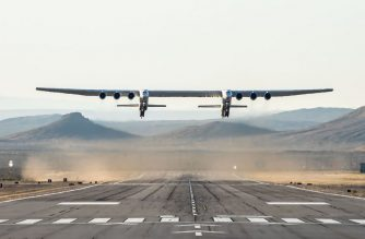 "This handout photograph obtained courtesy of Stratolaunch shows the Stratolaunch plane flying above the California desert, April 13, 2019, the first test flight of the US company's gigantic aircraft whose wingspan is almost half that of an Airbus A380. - The world's largest airplane -- a Stratolaunch behemoth with two fuselages and six Boeing 747 engines -- made its first test flight on Saturday, April 13, 2019 in California. The strange aircraft, built by the legendary aeronautical engineering company Scaled Composites in the Mojave Desert, has two fuselages and is powered by six Boeing 747 engines.  It must theoretically be used to carry and drop at altitude a small rocket that will then light its engine, and will propel to space to place satellites in orbit. This is a more flexible method of accessing the space than vertical rocket takeoffs, as a large take-off runway would suffice. (Photo by Handout / Stratolaunch Systems Corp / AFP) / == RESTRICTED TO EDITORIAL USE  / MANDATORY CREDIT:  ""AFP PHOTO /  STRATOLAUNCH"" /  NO MARKETING / NO ADVERTISING CAMPAIGNS /  DISTRIBUTED AS A SERVICE TO CLIENTS  =="
