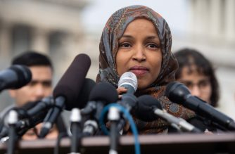 "(FILES) In this file photo taken on February 7, 2019 US Representative Ilhan Omar, Democrat of Minnesota, speaks during a press conference calling on Congress to cut funding for US Immigration and Customs Enforcement (ICE) and to defund border detention facilities, outside the US Capitol in Washington, DC. - White House press secretary Sarah Sanders on April 14, 2019 defended Donald Trump against accusations that he was inciting violence against a Muslim congresswoman after the president tweeted a video of her spliced with footage of the 9/11 attacks. Ilhan Omar, a Democratic lawmaker from Minnesota, has been at the center of an escalating row following a speech she made about Islamophobia in which she was accused by conservatives of downplaying the deadliest attacks on US soil by characterizing the event as ""some people did something."" (Photo by SAUL LOEB / AFP)"