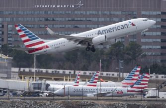 (FILES) In this file photo taken on March 11, 2019 a Boeing 737 flown by American Airlines passes by the Lockheed Martin building as it takes off from Ronald Reagan Washington National Airport in Arlington, Virginia. - American Airlines announced April 14, 2019, it would scrap some 115 flights per day in the coming months because its fleet of Boeing 737 MAX planes is being grounded until August 19. America's leading airline had previously only planned to keep the planes out of commission until June 5, with Boeing facing intense scrutiny after 157 people died in an Ethiopian Airlines 737 MAX crash on March 10 -- the second deadly crash involving the aircraft in five months.The global fleet of 737 MAX planes has been barred from flying since mid-March. (Photo by Andrew CABALLERO-REYNOLDS / AFP)