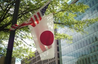 "(FILES) In this file photo taken on April 27, 2015 the US and Japan flags are seen on a lamp post near the White House in Washington, DC. - US and Japanese negotiators are set to open the first round of trade talks on April 15, 2019, in the latest front in President Donald Trump's aggressive, multi-pronged strategy to address ""chronic US trade imbalances.""After launching blistering tariffs on allies and rivals alike, Trump's trade team has completed a new North American trade pact with Canada and Mexico  -- the USMCA -- and one with South Korea, and  appears to be approach the final stages of a deal with China, while preparing for the start of negotiations with Europe. (Photo by Mandel NGAN / AFP)"