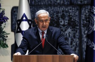"""Israeli Prime Minister Benjamin Netanyahu makes an address at the president's residence in Jerusalem on April 17, 2019. - Rivlin on April 17 formally handed Benjamin Netanyahu his letter of appointment to start building a coalition government following last week's elections. In a televised ceremony, Rivlin told Netanyahu that in consultations with all parties elected to the incoming 120-seat parliament, """"65 MPs recommended you"""". (Photo by MENAHEM KAHANA / AFP)"""
