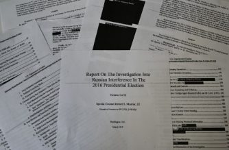 "An illustration shows printed pages of the redacted Mueller Report at an office on April 18, 2019, in Washington, DC. - US Attorney General Bill Barr said Thursday that the White House fully cooperated with Special Counsel Robert Mueller's probe of Russian election meddling and that President Donald Trump took no action to thwart the probe. ""There is substantial evidence to show that the president was frustrated and angered by a sincere belief that the investigation was undermining his presidency, propelled by his political opponents, and fueled by illegal leaks,"" Barr said ahead of the release of the Mueller report. (Photo by Eva HAMBACH / AFP)"