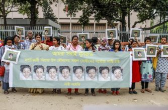 In this photo taken on April 12, 2019 Bangladeshi women hold banners and photographs of schoolgirl Nusrat Jahan Rafi at a protest in Dhaka, following her murder by being set on fire after she had reported a sexual assault. - A schoolgirl was burned to death in Bangladesh on the orders of her head teacher after she reported him for sexually harassing her, police said April 19. The death of 19-year-old Nusrat Jahan Rafi last week sparked protests across the South Asian nation, with the prime minister promising to prosecute all those involved. (Photo by SAZZAD HOSSAIN / AFP)