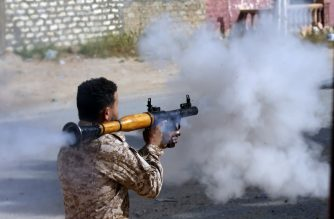 A Libyan fighter loyal to the Government of National Accord (GNA) fires a rocket propelled grenade during clashes with forces loyal to strongman Khalifa Haftar south of the capital Tripoli's suburb of Ain Zara, on April 20, 2019. - Forces loyal to Libya's unity government announced today a counter-attack against military strongman Khalifa Haftar's fighters, as clashes south of the capital Tripoli intensified. (Photo by Mahmud TURKIA / AFP)
