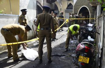Sri Lankan security personnel and investigators look through debris outside Zion Church following an explosion in Batticaloa in eastern Sri Lanka on April 21, 2019. - A series of eight devastating bomb blasts ripped through high-end hotels and churches holding Easter services in Sri Lanka on April 21, killing nearly 160 people, including dozens of foreigners. (Photo by LAKRUWAN WANNIARACHCHI / AFP)