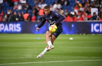 Paris Saint-Germain's French forward Kylian Mbappe kicks the ball prior to the French L1 football match between Paris Saint-Germain (PSG) and Monaco (ASM) on April 21, 2019 at the Parc des Princes stadium in Paris. (Photo by Anne-Christine POUJOULAT / AFP)