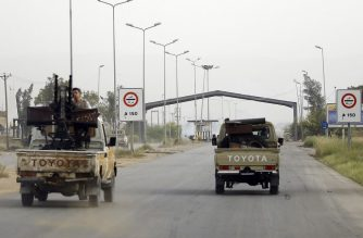 Vehicles belonging to Libyan fighters loyal to the Government of National Accord (GNA) are pictured during clashes with forces loyal to strongman Khalifa Haftar in al-Hira region 70 km south of the capital Tripoli, on April 23, 2019. - At least 264 people have been killed and over 1,200 wounded in weeks of fighting on the outskirts of Libya's capital, the World Health Organization said Tuesday, as African leaders gathered in Cairo to discuss the crisis. (Photo by Mahmud TURKIA / AFP)