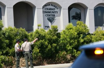San Diego Sheriff deputies look over the Chabad of Poway Synagogue after a shooting on Saturday, April 27, 2019 in Poway, California. - A gunman opened fire at a synagogue in California, killing one person and injuring three others including the rabbi as worshippers marked the final day of Passover, officials said Saturday, April 27, 2019. The shooting in the town of Poway came exactly six months after a white supremacist shot dead 11 people at Pittsburgh's Tree of Life synagogue -- the deadliest attack on the Jewish community in the history of the United States. (Photo by SANDY HUFFAKER / AFP)