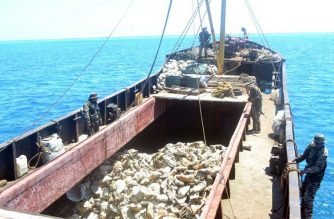 """(File photo) This undated handout photo taken by Philippine navy and released April 11, 2012 by the Department of Foreign Affairs shows Philippine navy troops inspecting a Chinese fishing vessel loaded giant clam shells after it was intercepted off scarborough Shoal which led to a tense standoff between Philippines' warship and Chinese maritime surveillance ships. The Philippines' biggest warship was locked in a standoff on April 11,  with two Chinese ships in the South China Sea, reigniting tensions in a decades-long dispute over the resource-rich waters.       AFP PHOTO/DFA/PN            ---EDITORS NOTE--- RESTRICTED TO EDITORIAL USE MANDATORY CREDIT """"AFP PHOTO /DFA/PN --- NO MARKETING NO ADVERTISING CAMPAIGNS - DISTRIBUTED AS A SERVICE TO CLIENTS (Photo by DFA/PN / DFA / AFP)"""