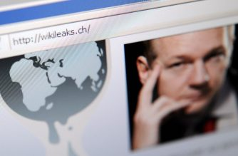 The homepage of Wikileaks.ch with a picture of its founder Julian Assange is seen on a computer screen on December 4, 2010 in Lausanne. WikiLeaks was battling to stay online after Sweden issued a new arrest warrant for its elusive boss Julian Assange, while PayPal axed donations access for the whistleblowing website. The Swiss address -- wikileaks.ch -- was up and running again after migrating to new servers.   AFP PHOTO / FABRICE COFFRINI (Photo by FABRICE COFFRINI / AFP)