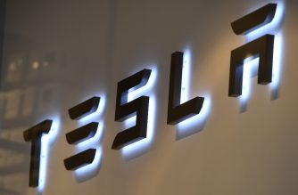This photo shows the logo if US car maker Tesla in Brussels on February 8, 2018 - A day after launching one of its cars into space, Tesla moved on February 7 to ease concerns on earth over production delays for its Model 3, the key to future growth for the star electric carmaker. (Photo by Emmanuel DUNAND / AFP)