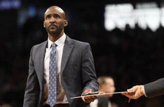 NEW YORK, NEW YORK - JANUARY 09: Head Coach Lloyd Pierce of the Atlanta Hawks looks on during a timeout in the second quarter of the game against the Brooklyn Nets at Barclays Center on January 9, 2019 in the Brooklyn borough of New York City. NOTE TO USER: User expressly acknowledges and agrees that, by downloading and or using this photograph, User is consenting to the terms and conditions of the Getty Images License Agreement.   Sarah Stier/Getty Images/AFP