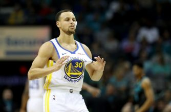 CHARLOTTE, NORTH CAROLINA - FEBRUARY 25: Stephen Curry #30 of the Golden State Warriors grabs his jersey against the Charlotte Hornets during their game at Spectrum Center on February 25, 2019 in Charlotte, North Carolina. NOTE TO USER: User expressly acknowledges and agrees that, by downloading and or using this photograph, User is consenting to the terms and conditions of the Getty Images License Agreement.   Streeter Lecka/Getty Images/AFP