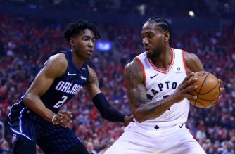 TORONTO, ON - APRIL 13: Kawhi Leonard #2 of the Toronto Raptors dribbles the ball as Wes Iwundu #25 of the Orlando Magic defends in the first half during Game One of the first round of the 2019 NBA Playoff at Scotiabank Arena on April 13, 2019 in Toronto, Canada. NOTE TO USER: User expressly acknowledges and agrees that, by downloading and or using this photograph, User is consenting to the terms and conditions of the Getty Images License Agreement.   Vaughn Ridley/Getty Images/AFP