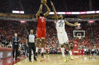 HOUSTON, TX - APRIL 24: James Harden #13 of the Houston Rockets takes a three point shot defended by Royce O'Neale #23 of the Utah Jazz in the second half during Game Five of the first round of the 2019 NBA Western Conference Playoffs between the Houston Rockets and the Utah Jazz at Toyota Center on April 24, 2019 in Houston, Texas. NOTE TO USER: User expressly acknowledges and agrees that, by downloading and or using this photograph, User is consenting to the terms and conditions of the Getty Images License Agreement.   Tim Warner/Getty Images/AFP