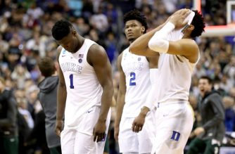 WASHINGTON, DC - MARCH 31: (L-R) Zion Williamson #1, Cam Reddish #2 and Tre Jones #3 of the Duke Blue Devils react after their teams 68-67 loss to the Michigan State Spartans in the East Regional game of the 2019 NCAA Men's Basketball Tournament at Capital One Arena on March 31, 2019 in Washington, DC.   Patrick Smith/Getty Images/AFP