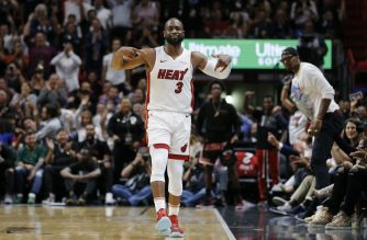MIAMI, FLORIDA - APRIL 09: Dwyane Wade #3 of the Miami Heat reacts after hitting a three pointer against the Philadelphia 76ers during the second half at American Airlines Arena on April 09, 2019 in Miami, Florida. NOTE TO USER: User expressly acknowledges and agrees that, by downloading and or using this photograph, User is consenting to the terms and conditions of the Getty Images License Agreement.   Michael Reaves/Getty Images/AFP