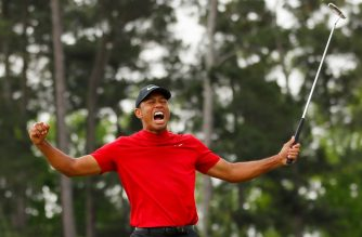 AUGUSTA, GEORGIA - APRIL 14: Tiger Woods of the United States celebrates after sinking his putt on the 18th green to win during the final round of the Masters at Augusta National Golf Club on April 14, 2019 in Augusta, Georgia.   Kevin C. Cox/Getty Images/AFP