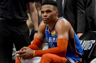 PORTLAND, OR - APRIL 16: Russell Westbrook #0 of the Oklahoma City Thunder looks on from the bench during the second half of Game Two of the Western Conference quarterfinals Portland Trail Blazers during the 2019 NBA Playoffs Moda Center on April 16, 2019 in Portland, Oregon. The Blazers won 114-94. NOTE TO USER: User expressly acknowledges and agrees that, by downloading and or using this photograph, User is consenting to the terms and conditions of the Getty Images License Agreement.   Steve Dykes/Getty Images/AFP (Photo by Steve Dykes/Getty Images)