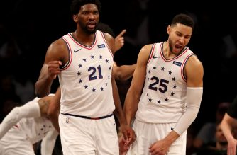 NEW YORK, NEW YORK - APRIL 20: Joel Embiid #21 and Ben Simmons #25 of the Philadelphia 76ers celebrate the win over the Brooklyn Nets at Barclays Center on April 20, 2019 in the Brooklyn borough of New York City.The Philadelphia 76ers defeated the Brooklyn Nets 112-108. NOTE TO USER: User expressly acknowledges and agrees that, by downloading and or using this photograph, User is consenting to the terms and conditions of the Getty Images License Agreement.   Elsa/Getty Images/AFP