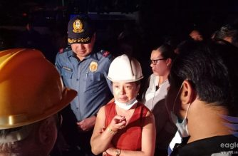 House Speaker Gloria Macapagal-Arroyo visits the site of the collapsed four-storey building in Porac, Pampanga where rescue and search operations are still ongoing to retrieve and rescue more quake survivors.  (Eagle News Service)