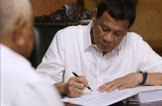 President Rodrigo Roa Duterte signs the 2019 General Appropriations Act at the Malacañan Palace on April 15, 2019. Witnessing the signing is Executive Secretary Salvador Medialdea. SIMEON CELI JR./PRESIDENTIAL PHOTO