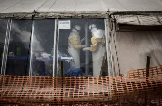 (FILES) In this file photo taken on March 9, 2019 health workers are seen inside the 'red zone' of an Ebola treatment centre, which was attacked in the early hours of the morning in Butembo. - The denial of the Ebola virus takes violent forms. The two treatment centers in Butembo and the neighboring city of Katwa were attacked by armed men last February and March, killing a policeman and wounding a health worker. (Photo by JOHN WESSELS / AFP)