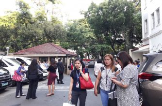 In photos: DOJ employees, visitors leave building after earthquake was felt in premises