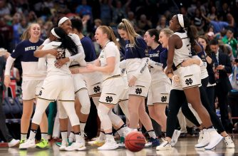 The Notre Dame Fighting Irish celebrate their win over the UConn Huskies in the semifinals of the 2019 NCAA Women's Final Four. (Photo Credit:   Mike Ehrmann/Getty Images/AFP)