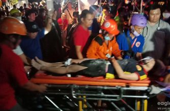 A quake survivor is recovered from the rubble by search and rescue teams working to pull out more people trapped in a four-storey building which collapsed in Porac, Pampanga following a 6.1 magnitude quake that hit Luzon in the Philippines.  (Eagle News Service)
