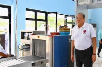 Transportation Secretary Arthur Tugade passes through the security machine at the nwwly rehabilitated Passenger Terminal Building of the Marinduque airport on Thursday, April 11./DOTr/