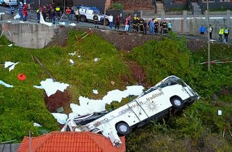 A video grab obtained from drone footage shows the wreckage of a tourist bus that crashed on April 17, 2019 in Canico, on the Portuguese island of Madeira. - At least 29 people were killed when a tourist bus crashed on the Portuguese island of Madeira, the local mayor told local media. The regional protection service did not confirm the toll when questioned by AFP. (Photo by STRINGER / AFP)