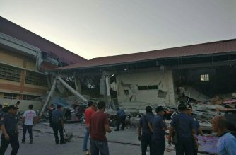 A four-storey building which housed a grocery store in the ground floor collapses in Porac, Pampanga after a 6.1 magnitude quake that shook Luzon in the Philippines (Eagle News Service)