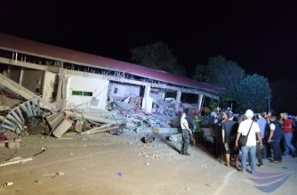 A four-storey building which housed a grocery store in the ground floor collapses in Porac, Pampanga after a 6.1 magnitude quake that shook Luzon in the Philippines.  The building stood beside a cultural sports and civic  center i (Eagle News Service)