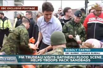 EBC exclusive video: Canadian PM Trudeau visits Gatineau flood scene, helps fill sandbags