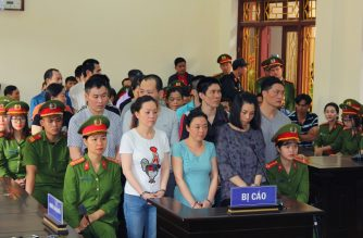 Defendants charged with illegal drug dealing and possession stand during a trial in a court in Vietnam's Ha Nam province on November 30, 2018. - Nine drug smugglers were sentenced to death in Vietnam on November 30 for selling methamphetamine and heroin in a country with some of the toughest drug laws in the world. (Photo by - / Vietnam News Agency / AFP)