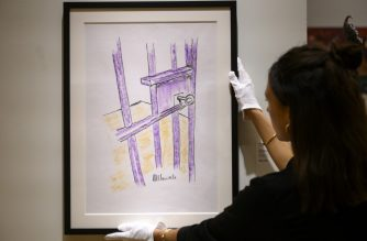 "A worker holds a sketch by Nelson Mandela -- ""The Cell Door, Robben Island"" -- on April 26, 2019 in New York City. - The sketch  will be offered at Bonhams Modern and Contemporary African Art sale in New York on May 2, 2019 with an estimate of $60,000-$90,000. (Photo by Johannes EISELE / AFP) / RESTRICTED TO EDITORIAL USE - MANDATORY MENTION OF THE ARTIST UPON PUBLICATION - TO ILLUSTRATE THE EVENT AS SPECIFIED IN THE CAPTION"