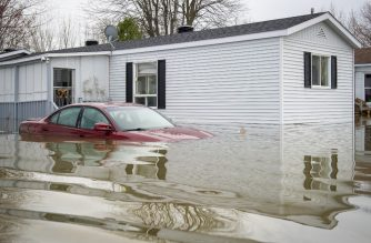 An automobile is submerged in flood waters in Sainte-Marthe-sur-le-Lac, a suburb of Montreal, Quebec, Canada, April 29, 2019. - More than 10,000 people have been evacuated from their homes in eastern Canada in recent days as spring floods broke record levels set in 2017, officials said Monday, April 29, 2019, warning that it could take weeks for the waters to recede.  Meanwhile an operation is underway to rescue pets from homes in the area that had to be abandoned during evacuations. Hardest hit was the town of Sainte-Marthe-sur-le-Lac, west of Montreal, where more than 6,000 people were forced to flee rising waters over the weekend after a natural dike was breached. (Photo by Sebastien St-Jean / AFP)