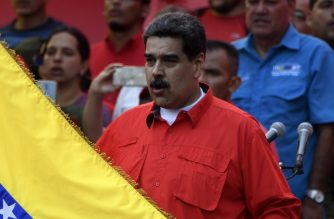 Venezuelan President Nicolas Maduro attends a May Day rally in Caracas on May 1, 2019. - Opposition supporters demonstrated for a second consecutive day in support of their country's self-proclaimed leader Juan Guaido as he bids to overthrow President Nicolas Maduro. Maduro and his government have vowed to put down what they see as an attempted coup by the US-backed opposition leader. (Photo by Juan BARRETO / AFP)