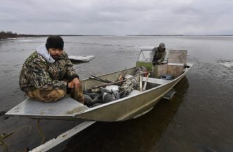 """Hunters prepares to search for geese and ducks in the town of Napakiak on the Yukon Delta in Alaska on April 19, 2019. - According to climate change reports from scientists, Alaska has been warming twice as fast as the global average, with temperatures in February and March shattering records. """"From 1901 to 2016, average temperatures in the mainland United States increased by 1.8 degrees Fahrenheit (one degree Celsius), whereas in Alaska they increased by 4.7 degrees,"""" said Rick Thoman, a climate expert at the Alaska Center for Climate Assessment and Policy. (Photo by Mark RALSTON / AFP)"""