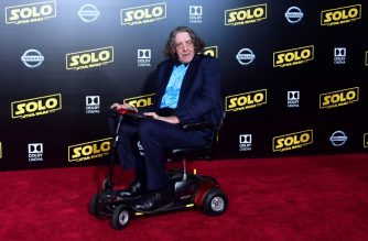 "(FILES) In this file photo taken on May 10, 2018 actor Peter Mayhew, who played the original Chewbacca, arrives for the premiere of the film 'Solo: A Star Wars Story' in Hollywood, California. - Actor Peter Mayhew, who won over fans worldwide as the Wookiee warrior Chewbacca in the blockbuster ""Star Wars"" movies, has died at the age of 74, his family announced on May 2, 2019. Mayhew died on Tuesday at his home in Texas, surrounded by loved ones, the family said in a statement released on the actor's Twitter account. (Photo by Frederic J. BROWN / AFP)"