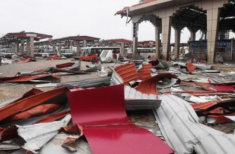 Debris litters the floor at a bus stand in Puri on May 5, 2019, after Cyclone Fani swept through the area. - Cyclone Fani, one of the biggest to hit India in years, tore into Odisha on May 3, leaving a trail of devastation across the coastal state of 46 million people before swinging towards Bangladesh. (Photo by Dibyangshu SARKAR / AFP)