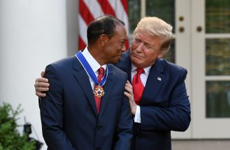 US President Donald Trump presents US golfer Tiger Woods with the Presidential Medal of Freedom during a ceremony in the Rose Garden of the White House in Washington, DC, on May 6, 2019. (Photo by SAUL LOEB / AFP)